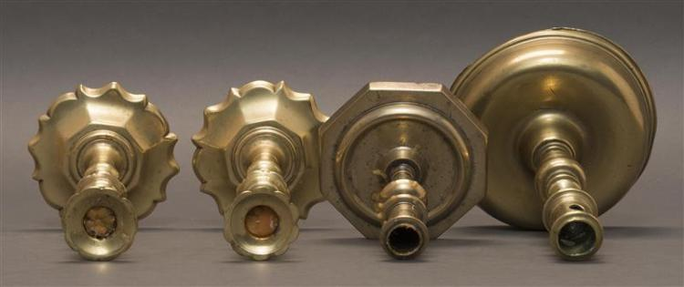 FOUR BRASS CANDLESTICKS Includes a pair and two singles. Heights from 5.5