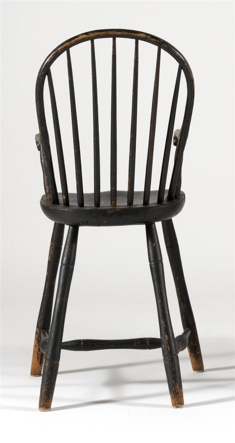ANTIQUE AMERICAN WINDSOR BOWBACK YOUTH CHAIR In old black paint with seven-spindle back, delicate scrolled arms, saddle seat and bam...