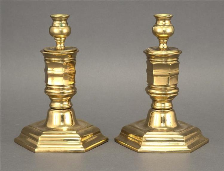 PAIR OF BRASS CANDLESTICKS With bulbous bobèches, turned stems and stepped hexagonal bases. Heights 8