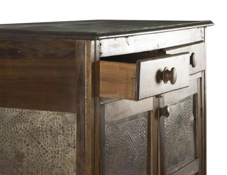 PIE SAFE In pine, walnut and other woods under a brown finish. Two half drawers with turned wooden pulls over two doors inset with p...