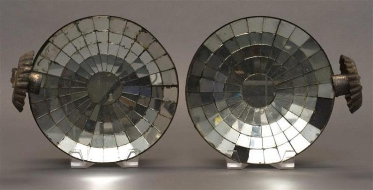 PAIR OF MIRROR-BACK WALL SCONCES Both with circular mosaic reflectors, single socles and pinched drip trays. Heights 9.25