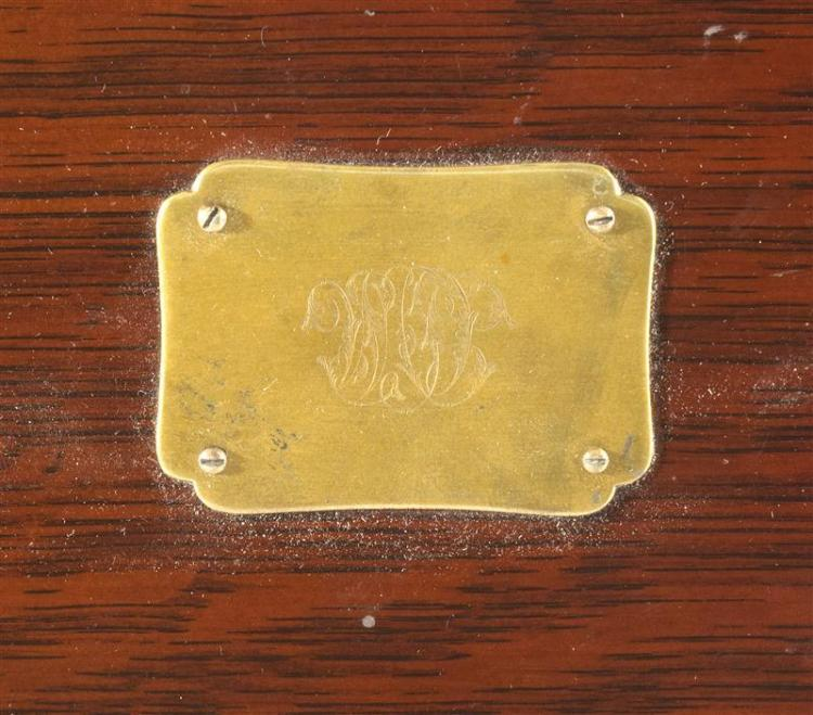 BRASS-MOUNTED OAK FLATWARE CHEST ON STAND Interior labeled for The Mauser MTG Co., New York. Hinged cover with central monogrammed c...