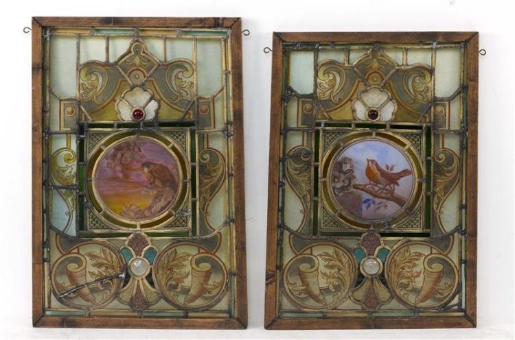 PAIR OF VICTORIAN STAINED AND LEADED GLASS PANELS Rectangular panels, both with central painted rondel depicting a robin surrounded...