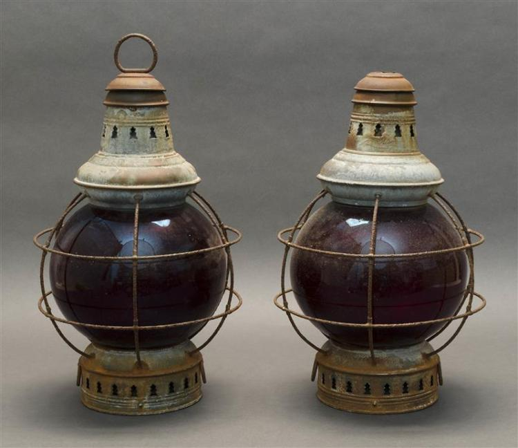 "PAIR OF BRASS ONION LAMPS With red glass globes. Heights 15.5""."