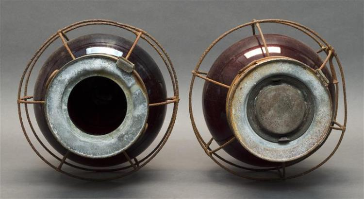 PAIR OF BRASS ONION LAMPS With red glass globes. Heights 15.5