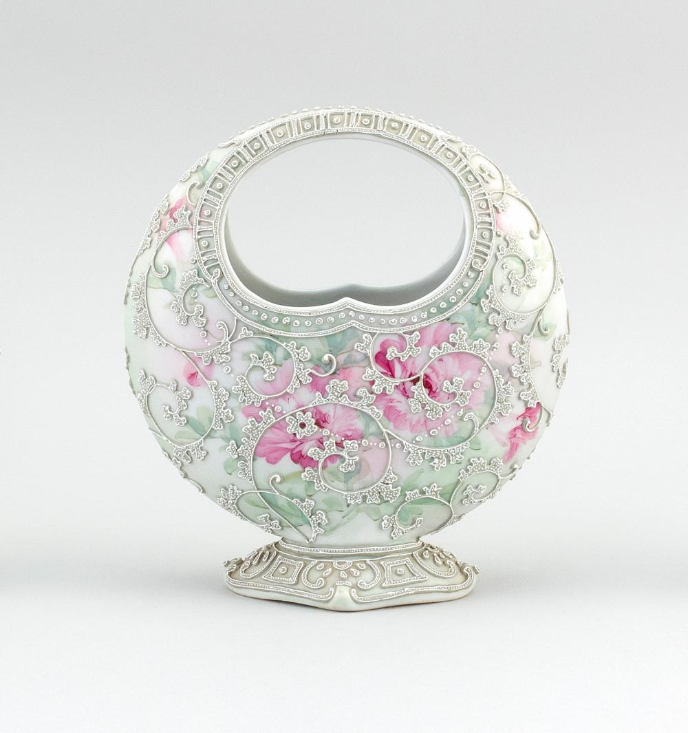 """MORIAGE NIPPON PORCELAIN VASE In basket form, with moriage vines on a pink floral-patterned ground. Height 8.75""""."""