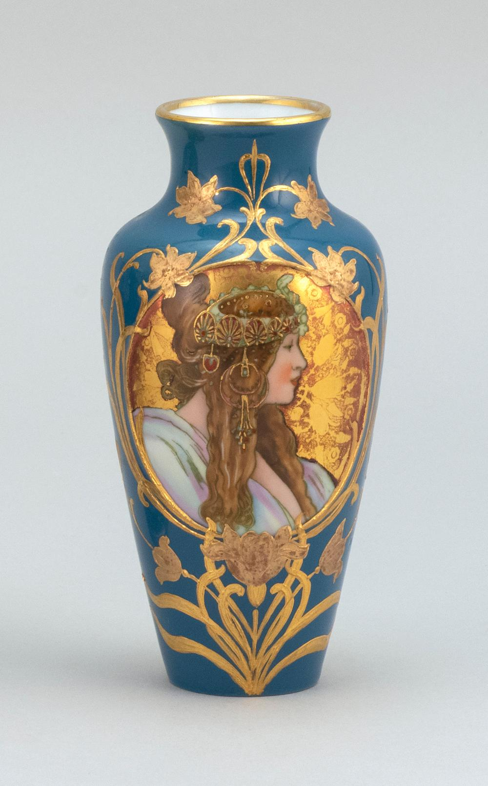 """PORCELAIN VASE With an Art Nouveau-style portrait of a woman on a teal blue ground. Potter's mark on base. Height 5.6""""."""