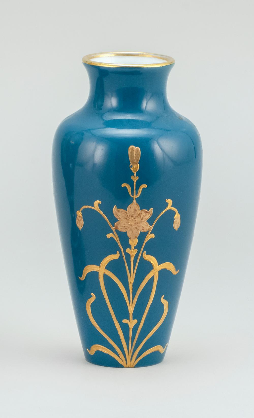 PORCELAIN VASE With an Art Nouveau-style portrait of a woman on a teal blue ground. Potter's mark on base. Height 5.6