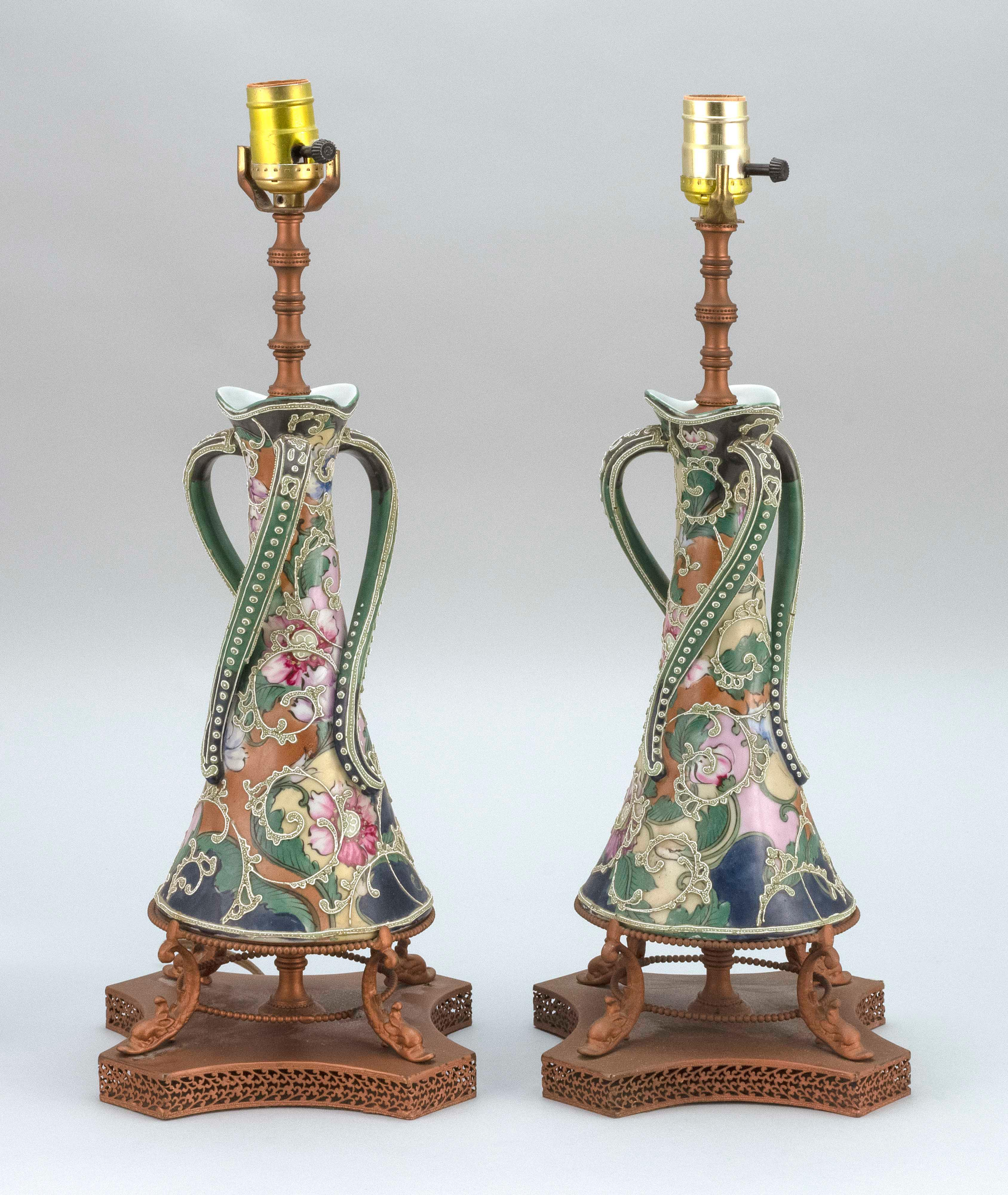 PAIR OF MORIAGE NIPPON PORCELAIN VASES Conical, with three twisting handles and floral and foliate decoration. Mounted as table lamp...