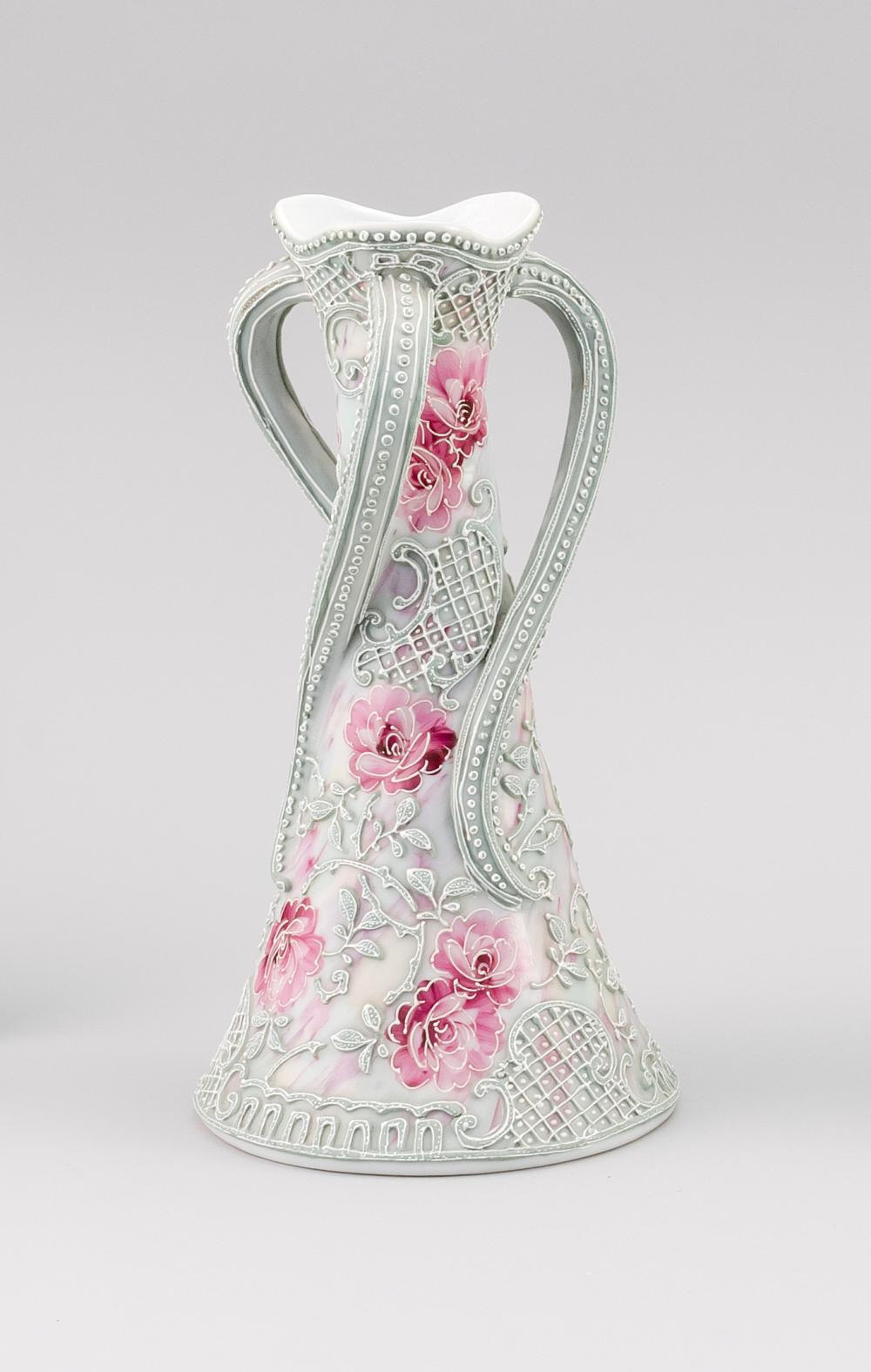 MORIAGE NIPPON PORCELAIN VASE Conical, with three twisting handles and rose decoration. Height 10