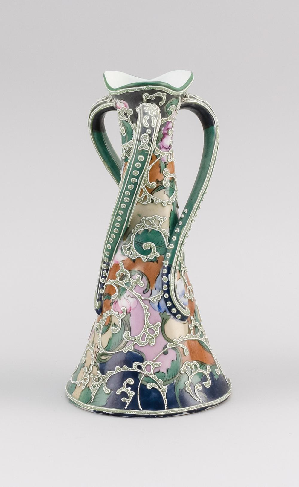 MORIAGE NIPPON PORCELAIN VASE Conical, with three twisting handles and an elaborate floral design. Height 10.5