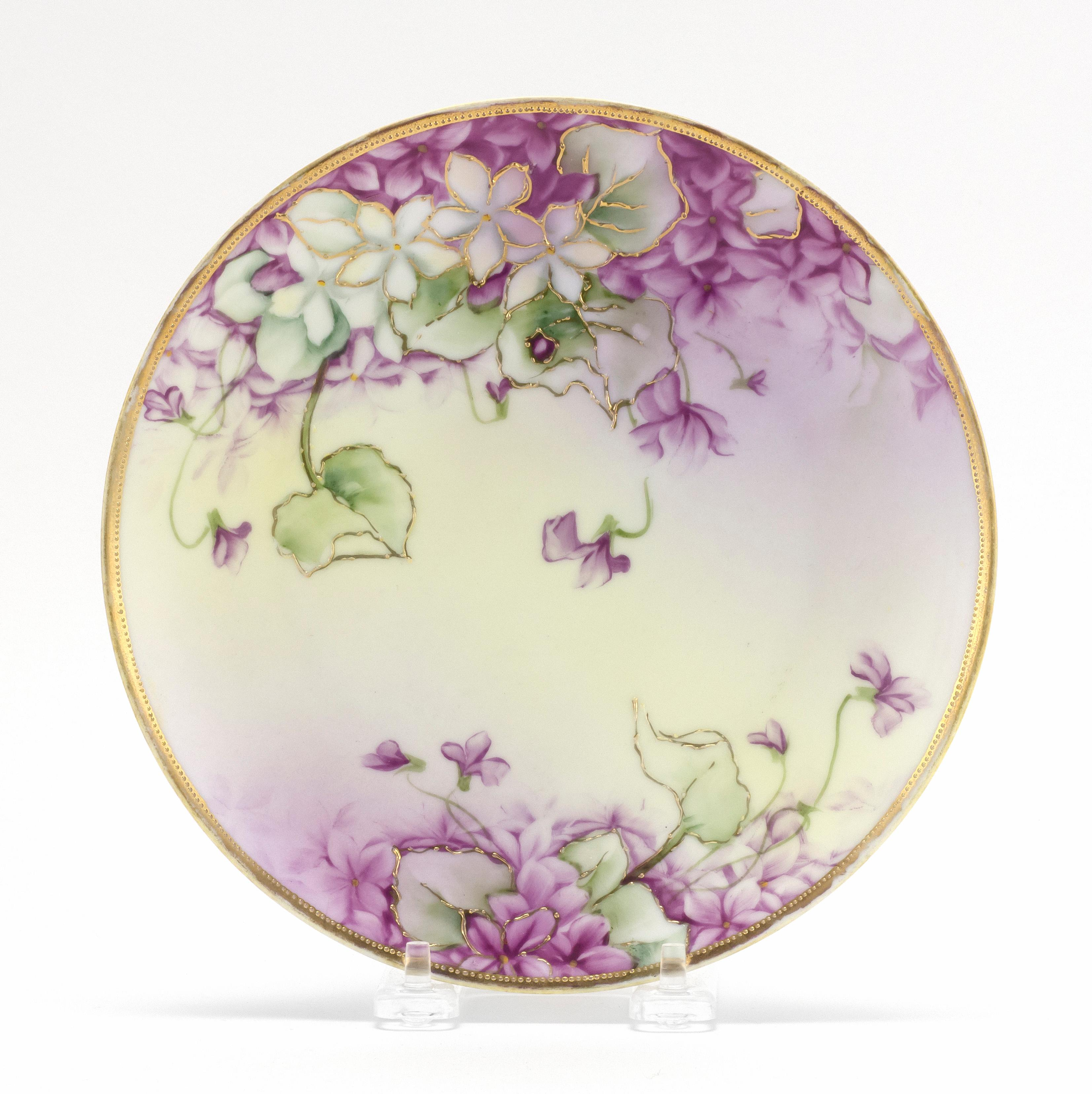 "NIPPON PORCELAIN PLATE With decoration of violets. Van Patten #52 mark on base. Diameter 7.75""."