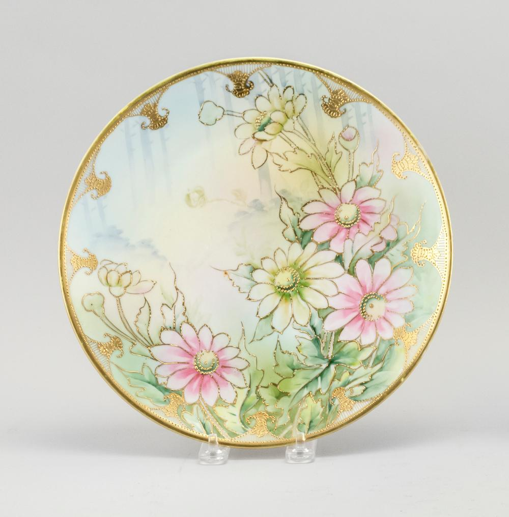 "NIPPON PORCELAIN PLATE With chrysanthemum decoration highlighted by gilding. Van Patten #52 mark on base. Diameter 10.25""."