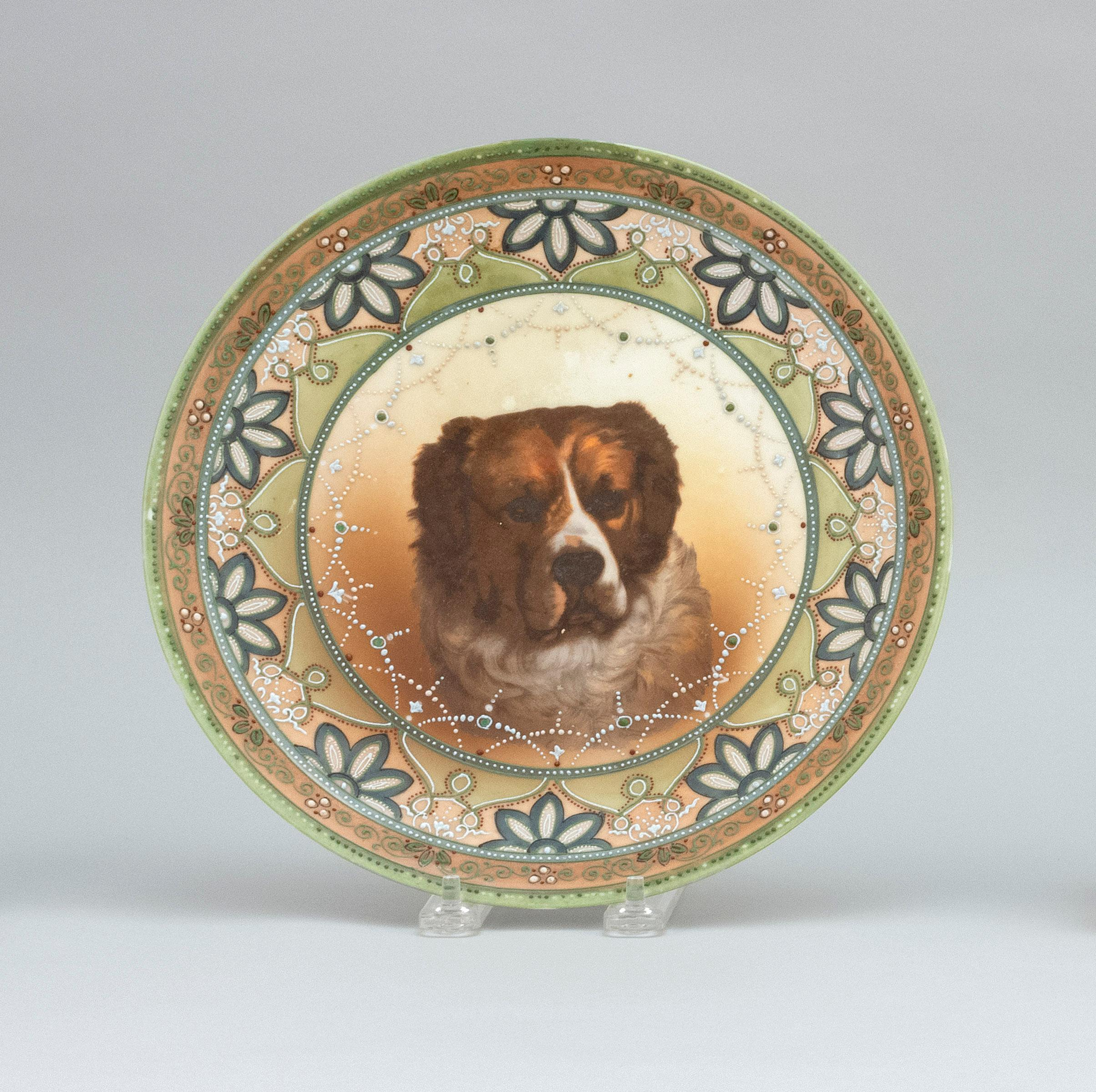 "NIPPON PORCELAIN PLATE With dog portrait surrounded by moriage flowers. Van Patten #52 mark on base. Diameter 10""."
