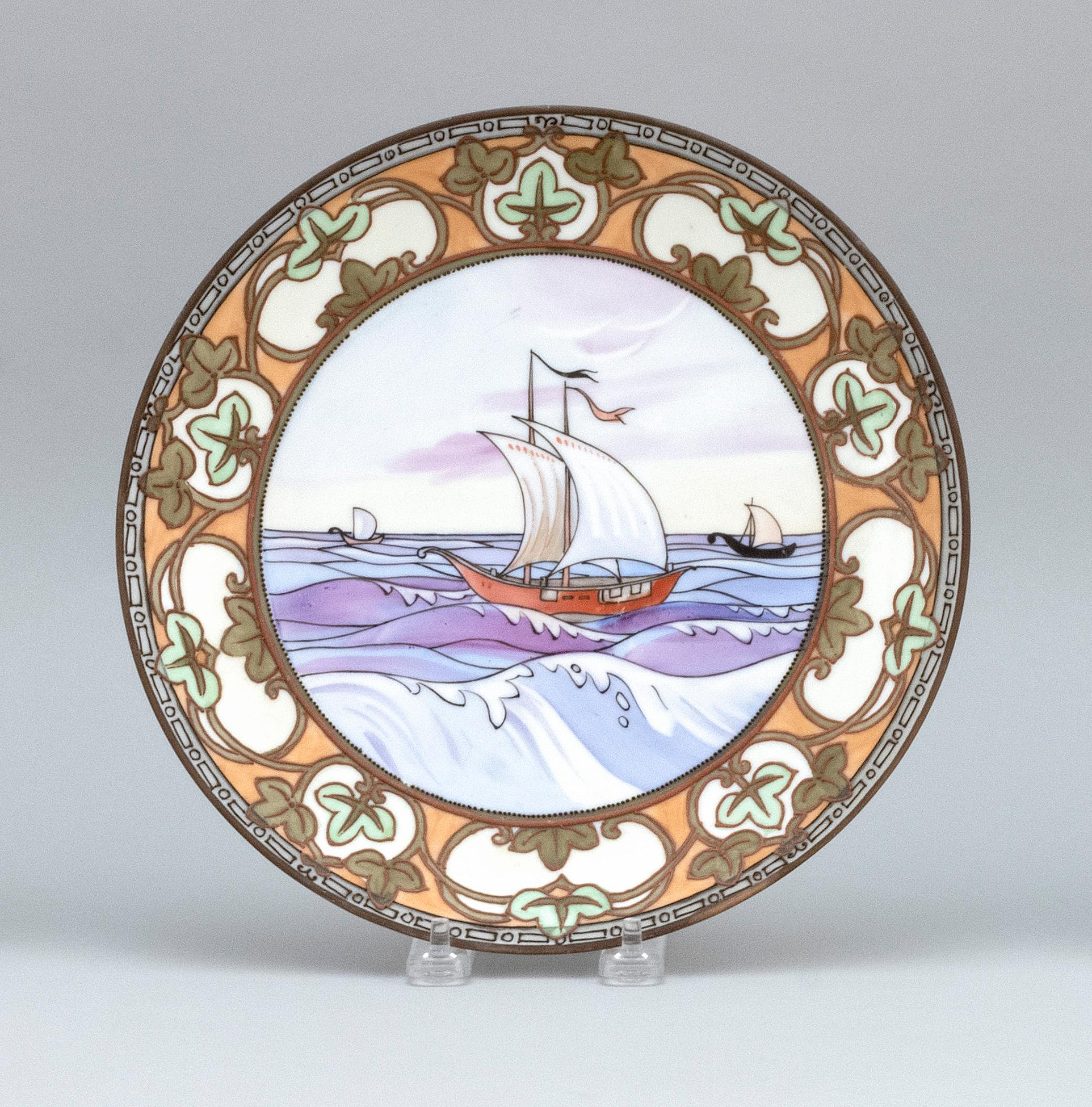 "NIPPON PORCELAIN PLATE With Norse sailing scene and moriage floral border. Diameter 10""."