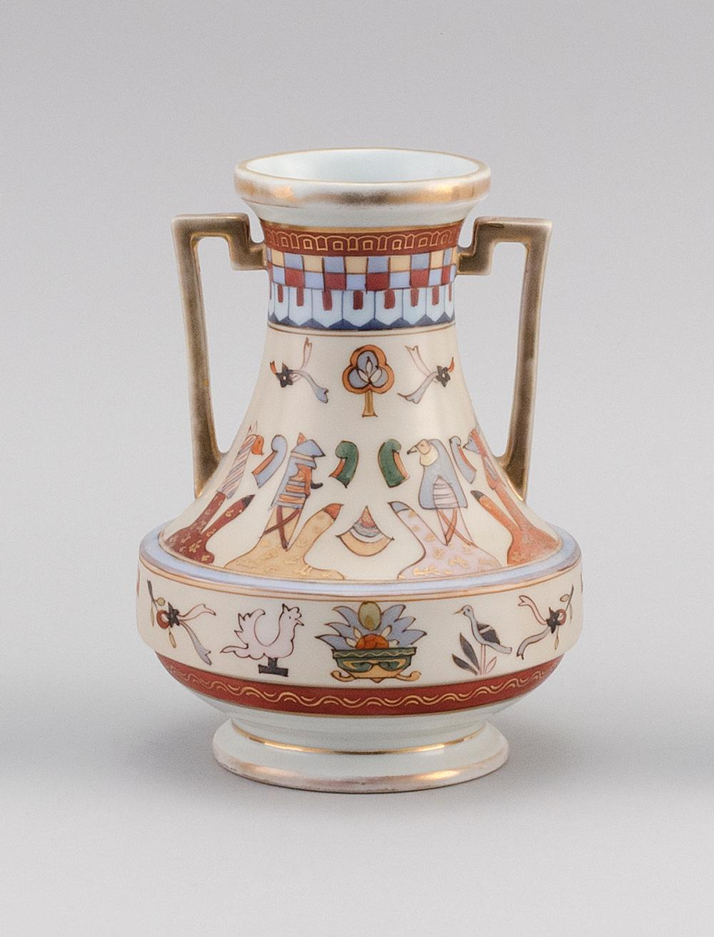 NIPPON PORCELAIN VASE In waisted form, with geometric handles and decoration of Egyptian motifs. Van Patten #47 mark on base. Height...
