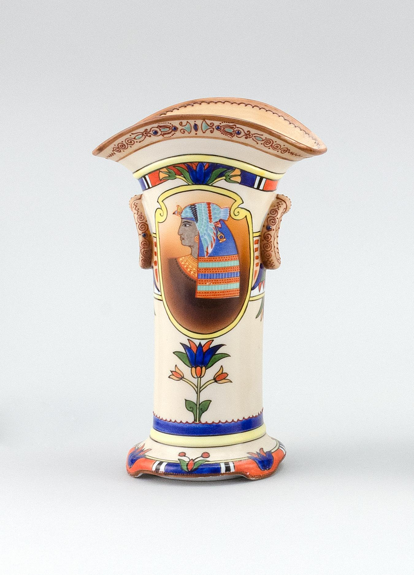 NIPPON PORCELAIN VASE In flared form, with mock ring handles and decoration of Egyptian motifs. Van Patten #47 mark on base. Height...