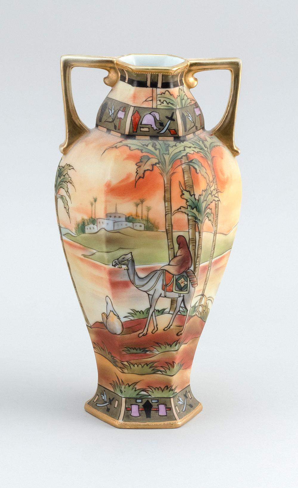 NIPPON PORCELAIN VASE Hexagonal, with openwork handles and Egyptian landscape decoration. Van Patten #47 mark on base. Height 10.3