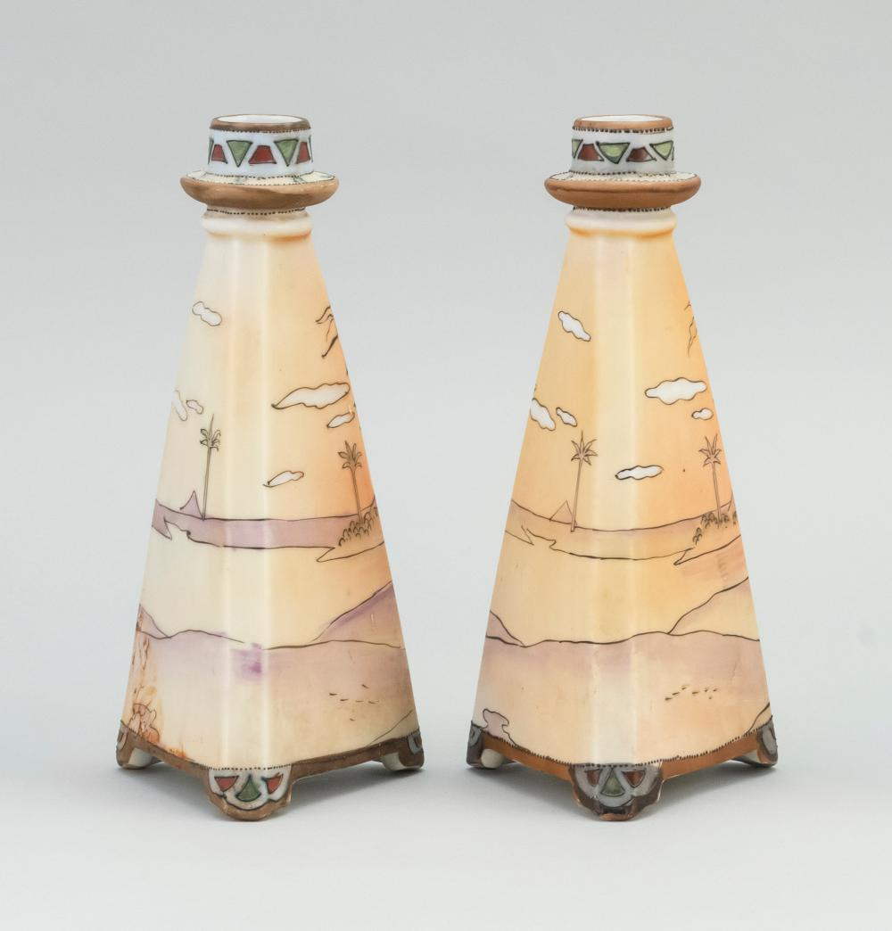 PAIR OF NIPPON PORCELAIN CANDLESTICKS In pyramid form, with Egyptian landscape decoration. Van Patten #47 mark on bases. Heights 8