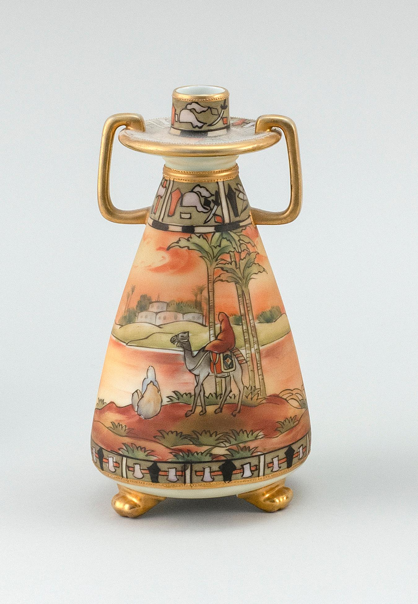 """NIPPON PORCELAIN CANDLESTICK In tripod conical form, with Egyptian landscape decoration. Van Patten #47 mark on base. Height 7.7""""."""