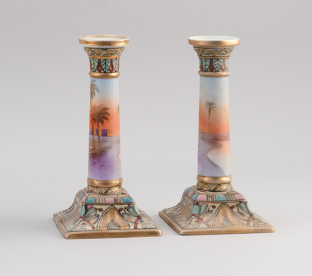 PAIR OF NIPPON PORCELAIN CANDLESTICKS With Egyptian landscape decoration. Van Patten #47 mark on bases. Heights 9.2