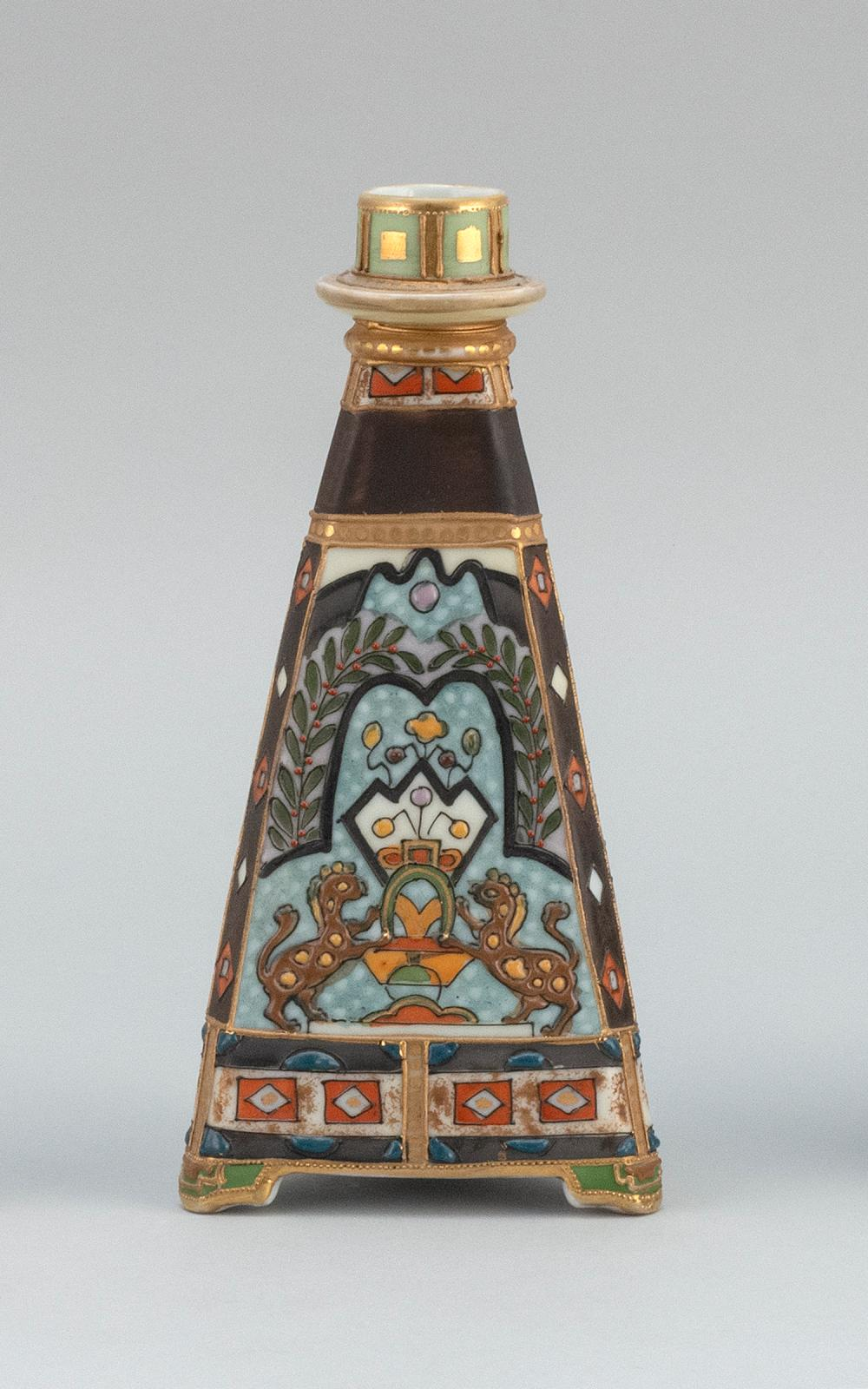 """NIPPON PORCELAIN CANDLESTICK In pyramid form, with relief design of a lion crest. Van Patten #47 mark on base. Height 8""""."""