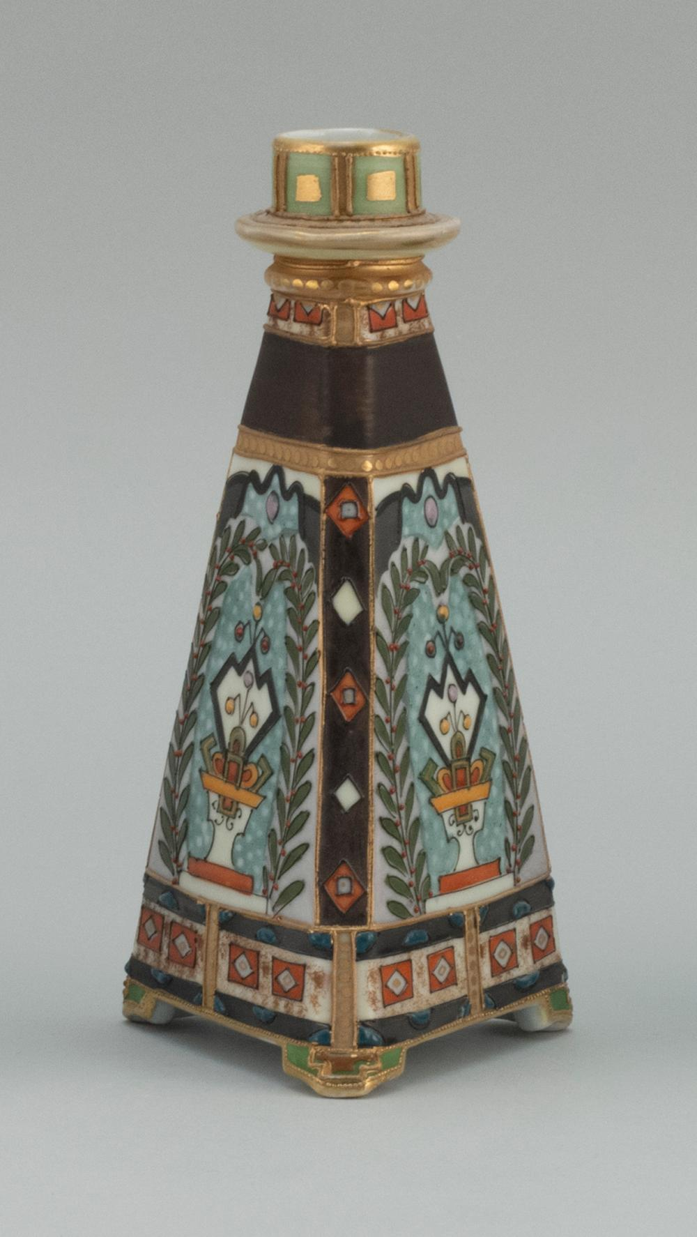 NIPPON PORCELAIN CANDLESTICK In pyramid form, with relief design of a lion crest. Van Patten #47 mark on base. Height 8