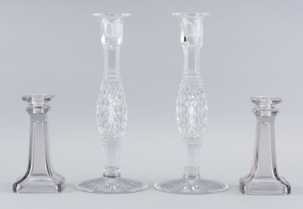 """TWO PAIRS OF GLASS CANDLESTICKS 1) Cut crystal with diaper-cut stems. Unmarked. Heights 12"""". 2) Molded glass. Unmarked. Heights 6.25""""."""