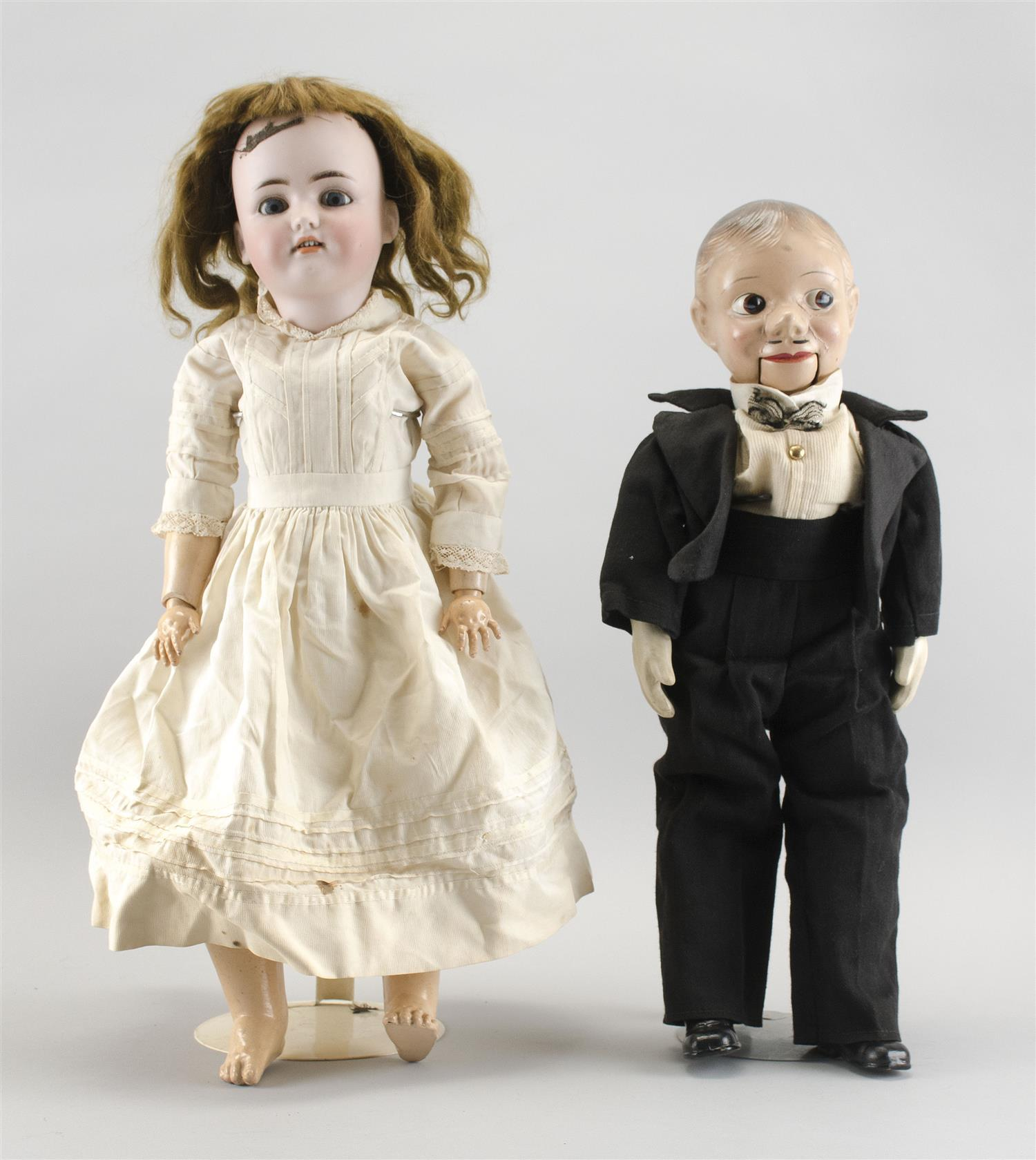 """COMPOSITION CHARLIE MCCARTHY VENTRILOQUIST DOLL Together with a circa 1910 Simon & Halbig #550 bisque-head doll, height 23"""". Charlie..."""