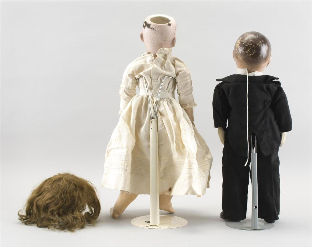 COMPOSITION CHARLIE MCCARTHY VENTRILOQUIST DOLL Together with a circa 1910 Simon & Halbig #550 bisque-head doll, height 23