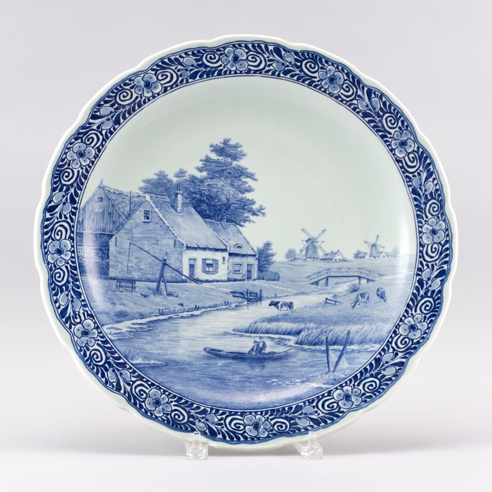 """DELFT BLUE AND WHITE WALL CHARGER Depicts boaters and cows along a canal with distant windmills. Signed lower center """"J. Sonnaville""""..."""