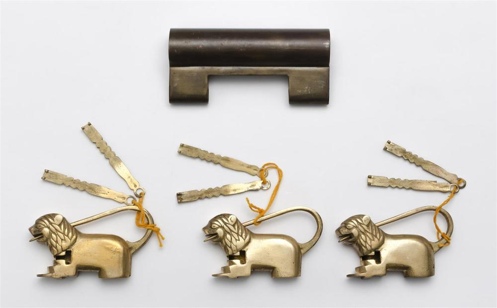 """THREE CHINESE/INDIAN FIGURAL BRASS LOCKS Together with a large brass lock, no key. Length 4.5"""". Figural lock lengths 3""""."""