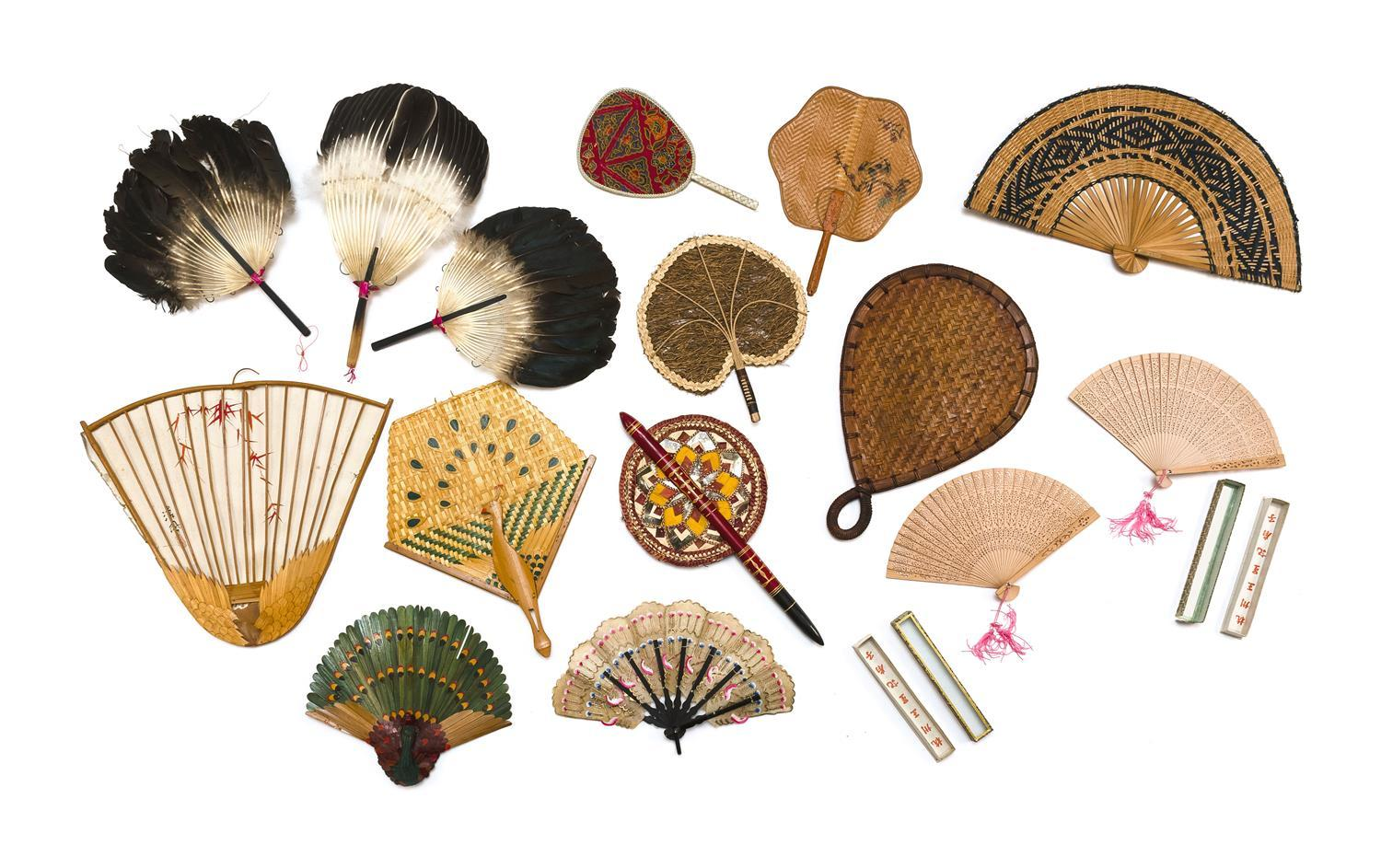 FIFTEEN ASIAN FANS 1-3) Three goose feather fixed hand fans. 4-5) Two pierced sandalwood brise fans. Boxed. 6-7) Two decorative pain...