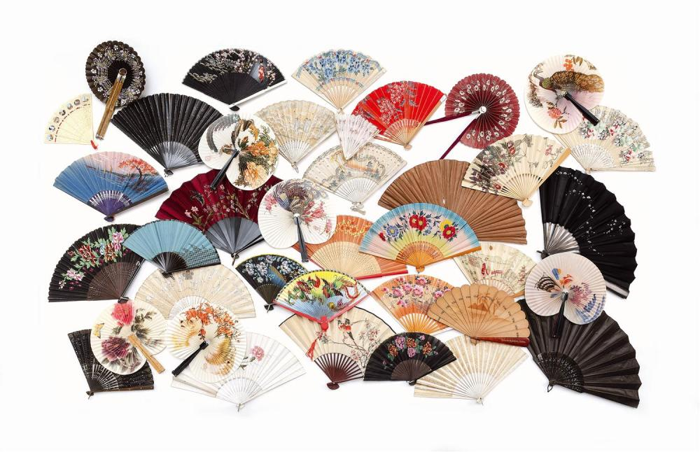 """THIRTY-EIGHT FANS 1) Wood brisé souvenir fan from Cairo with shadow design of palm trees and pyramids. Inscribed """"Gabriel G. Hakim,..."""