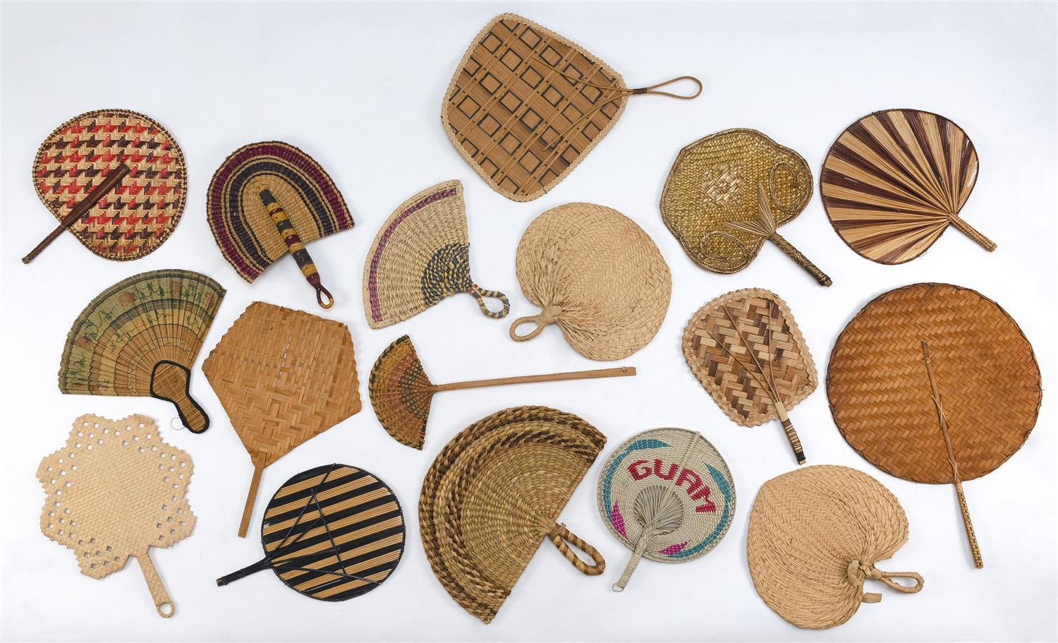 APPROX. SEVENTEEN MICRONESIAN AND AFRICAN FIXED HAND FANS Includes several from Java, Bali and the Hawaiian Islands made from raffia...