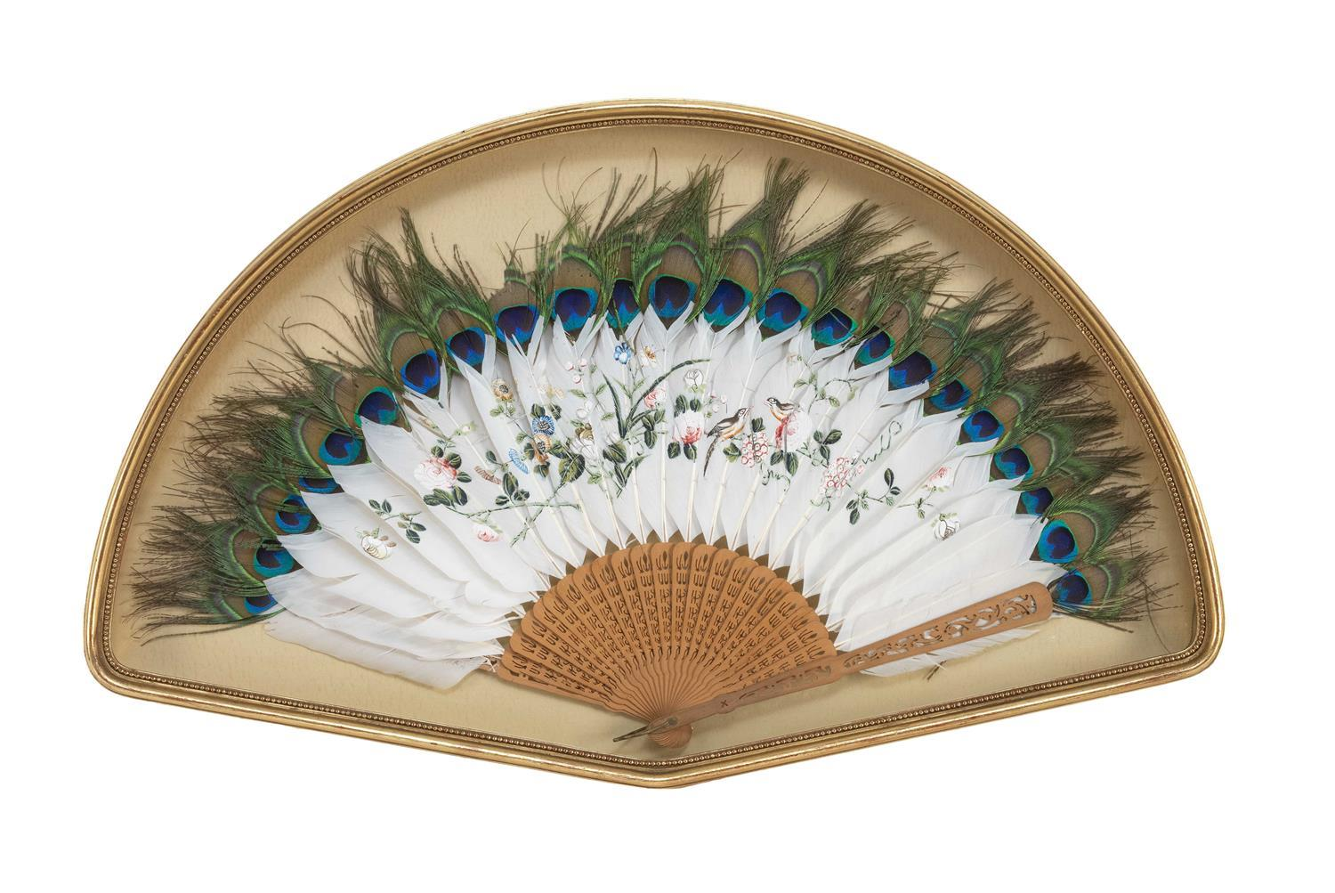"""CASED FEATHER AND SANDALWOOD FAN Tipped with peacock """"eyes"""". Goose feathers painted with a charming array of birds and flowers. Carv..."""