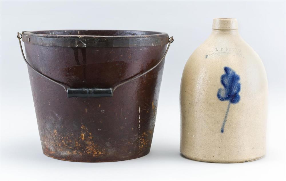 "NORTON STONEWARE JUG Together with a red-painted pressed fiberboard fire bucket, height 10"". Jug with cobalt blue floral decoration...."