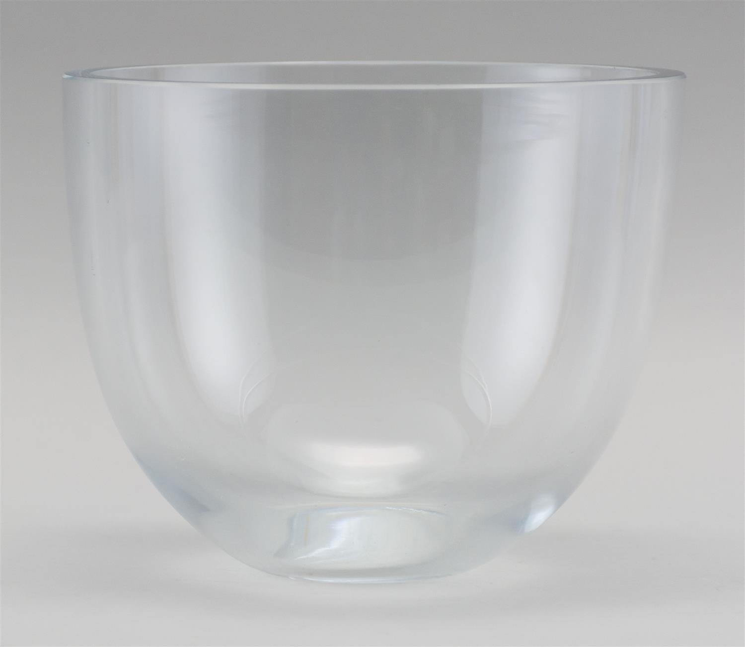 """CLEAR ART GLASS BOWL With thick walled sides and a flat rim. Signed on """" Strömbergshyttan"""" base. Height 6"""". Diameter 7.5""""."""