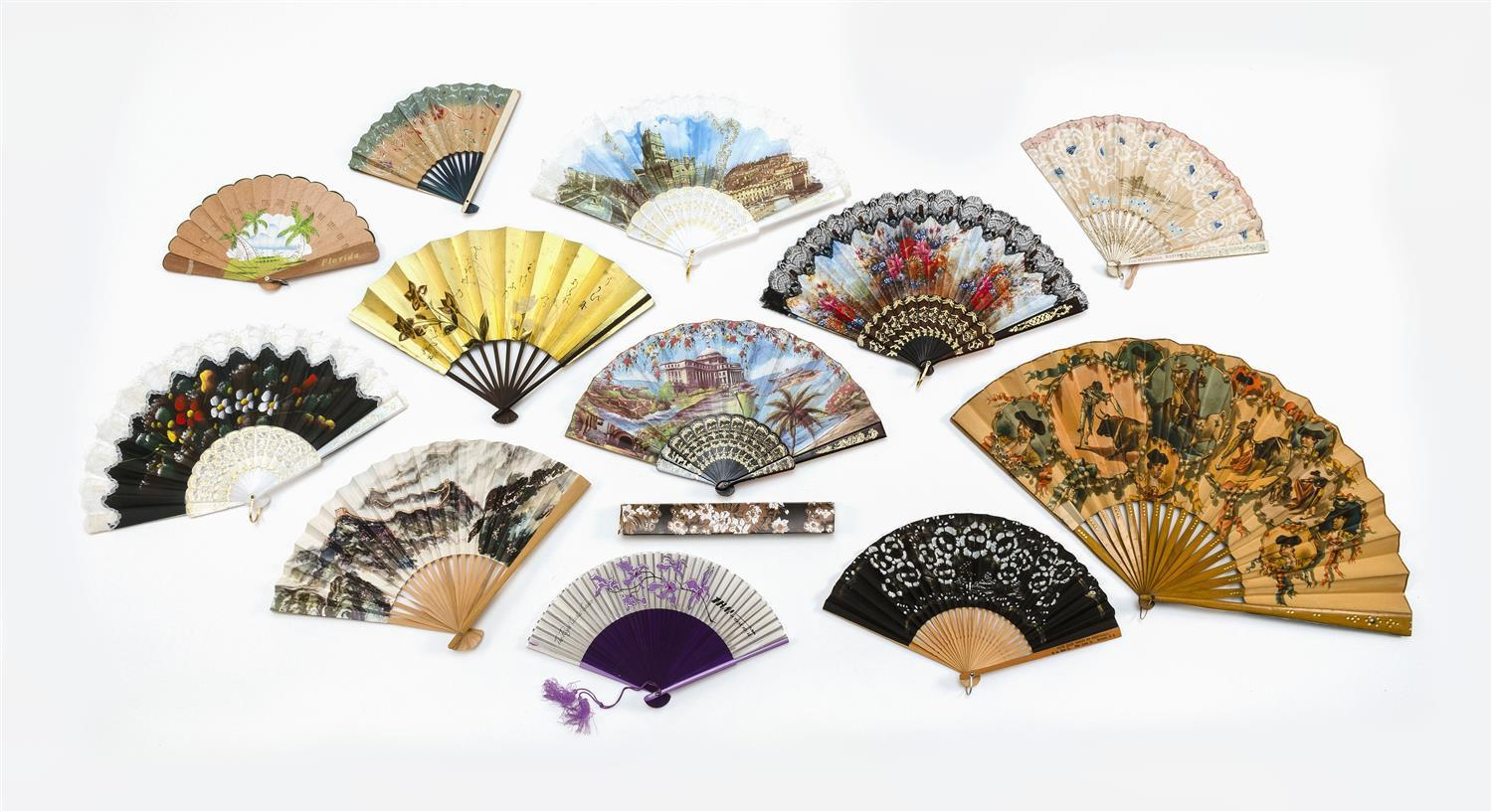 TWELVE SOUVENIR AND ADVERTISING FANS 1) Large Spanish wood and paper folding fan illustrating scenes of bullfighting and with cartou...