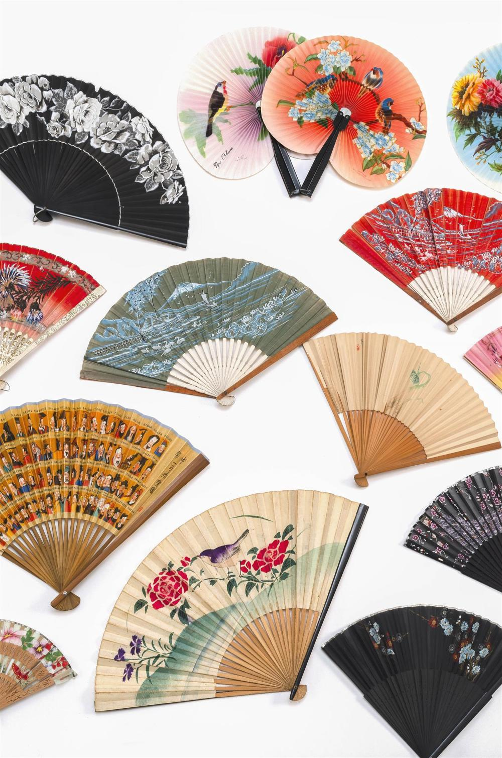 TWENTY-SIX ASIAN FANS 1-7) Seven Chinese metal and paper cockade fans. Lengths closed 5.5