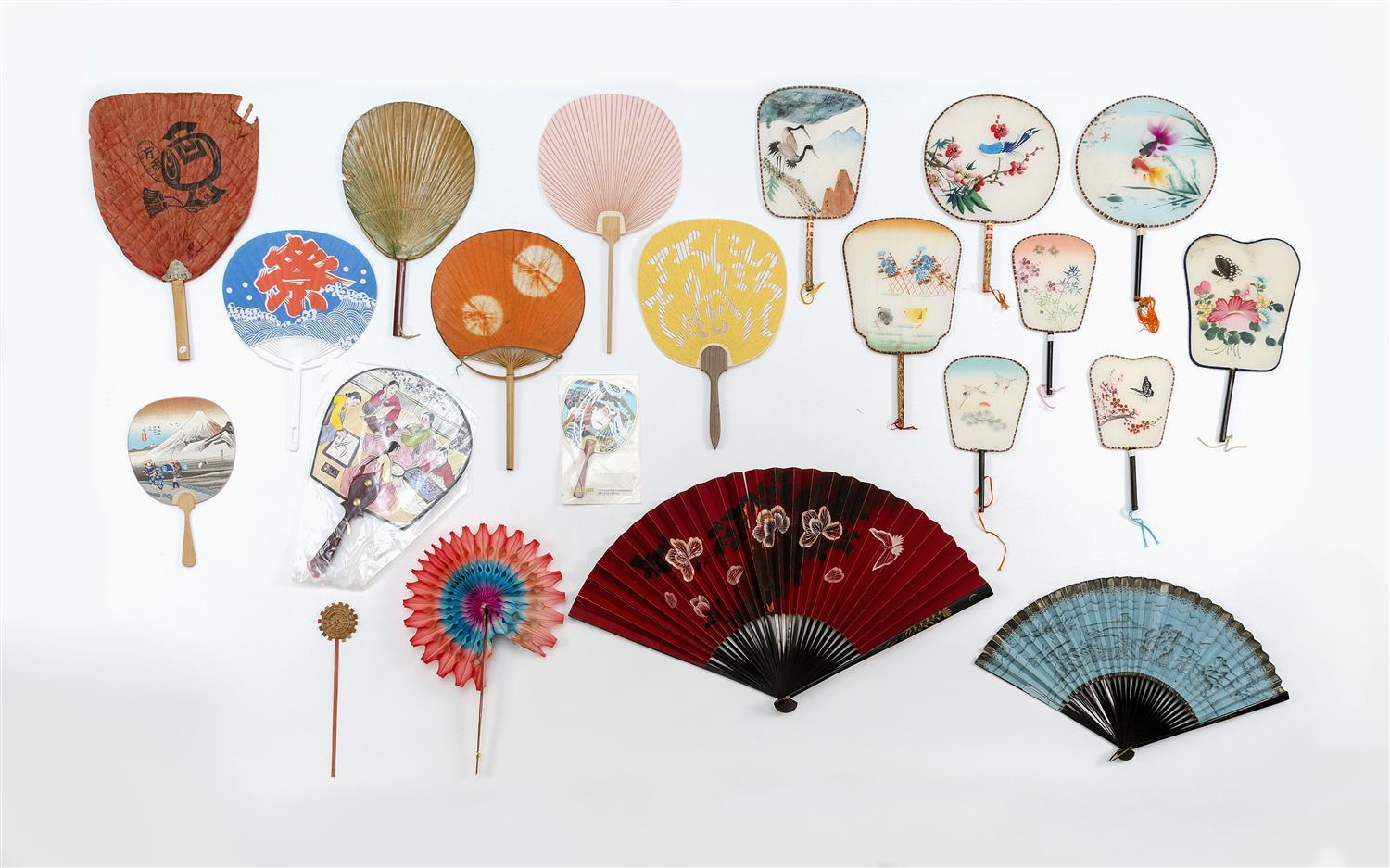 """TWENTY-ONE ASIAN FANS Includes two Japanese black lacquer and paper folding fans, lengths 14.75"""" and 11"""" and eight colorful Chinese..."""