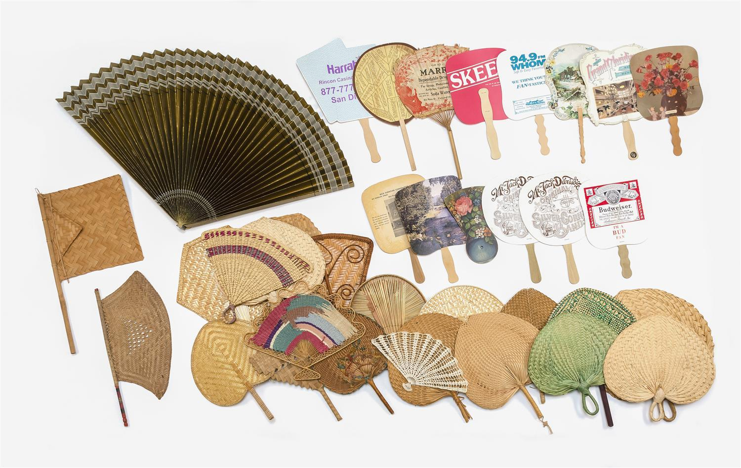 APPROX. THIRTY-SEVEN FANS Includes 21 woven grass fixed hand fans, 14 mostly paper and wood fixed hand fans and others. Notable exam...