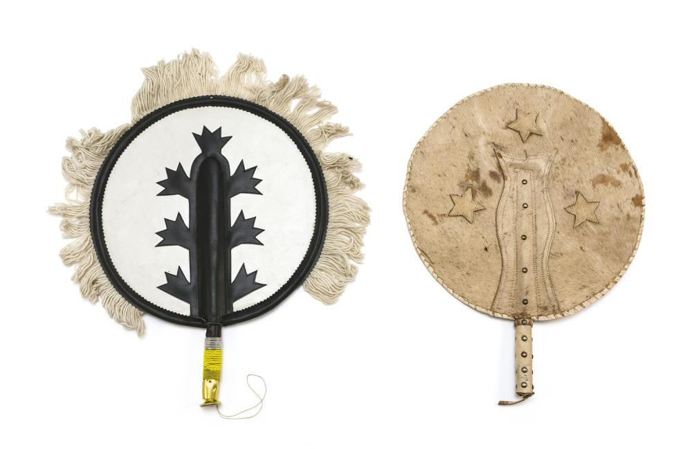 TWO UNIQUE LARGE COWBOY OR AFRICAN FIXED HAND FANS 1) Double-sided. Possibly cowhide, with three applied stars and rivet decoration....