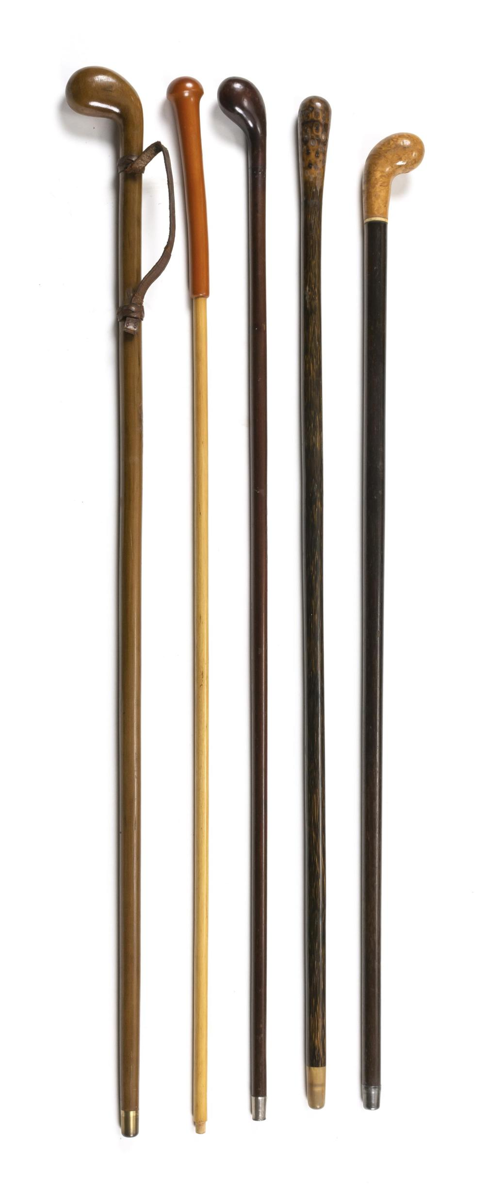 "FIVE CANES Mostly wood. One with horn ferrule. One with leather wrist cord and metal ferrule. Lengths from 34"" to 35.5""."