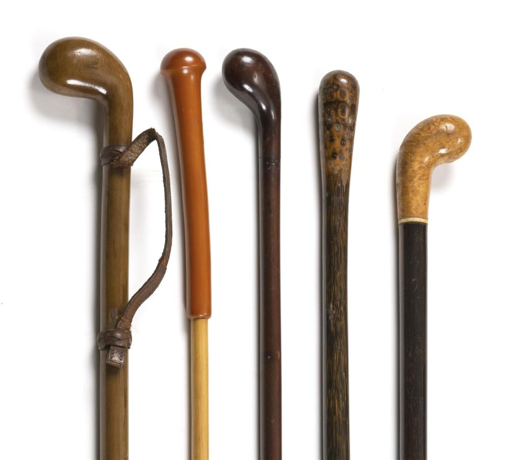 FIVE CANES Mostly wood. One with horn ferrule. One with leather wrist cord and metal ferrule. Lengths from 34