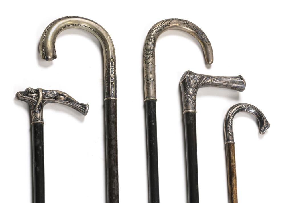 FIVE CANES WITH SILVER HANDLES Handles in assorted shapes and designs. All with wooden shafts and metal ferrules. Lengths from 34