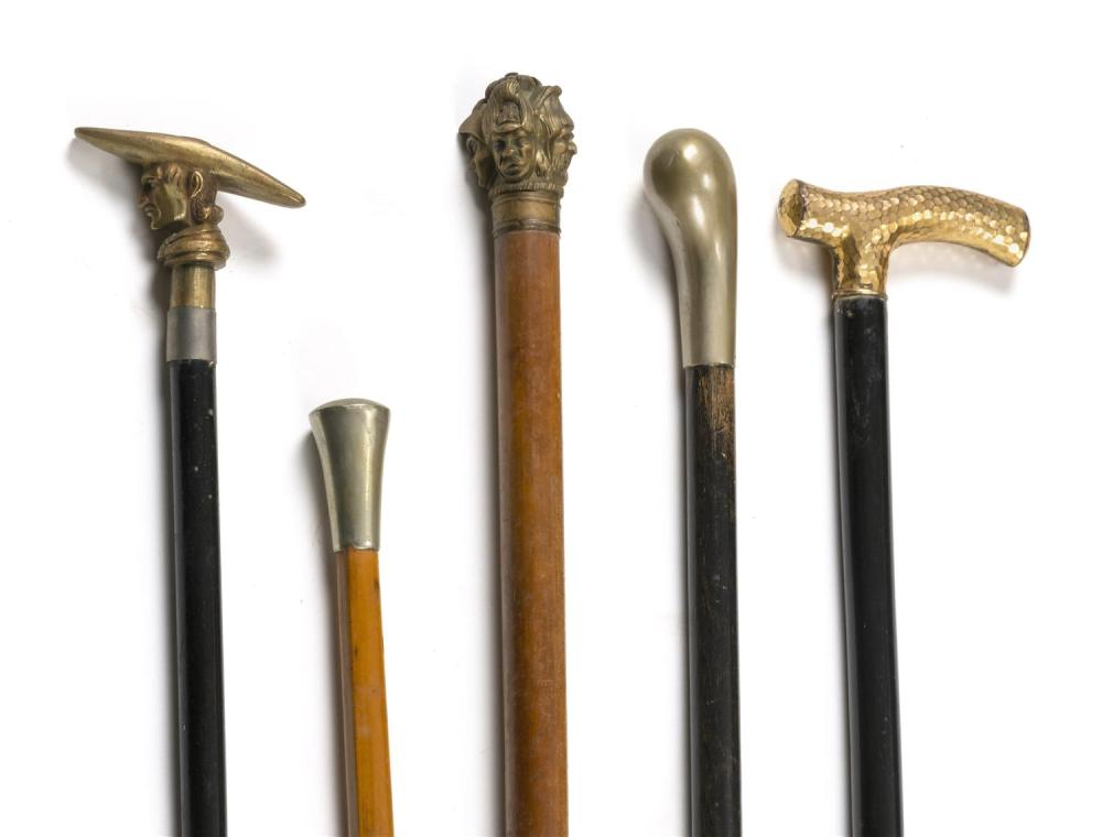 FIVE CANES WITH METAL HANDLES Handles in assorted metals and styles; two are figural. All with wooden shafts. Lengths from 30