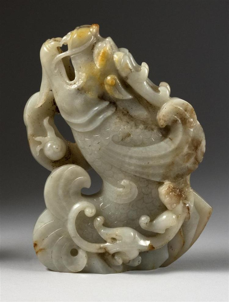 Chinese white and russet jade carving in the form of a leapi