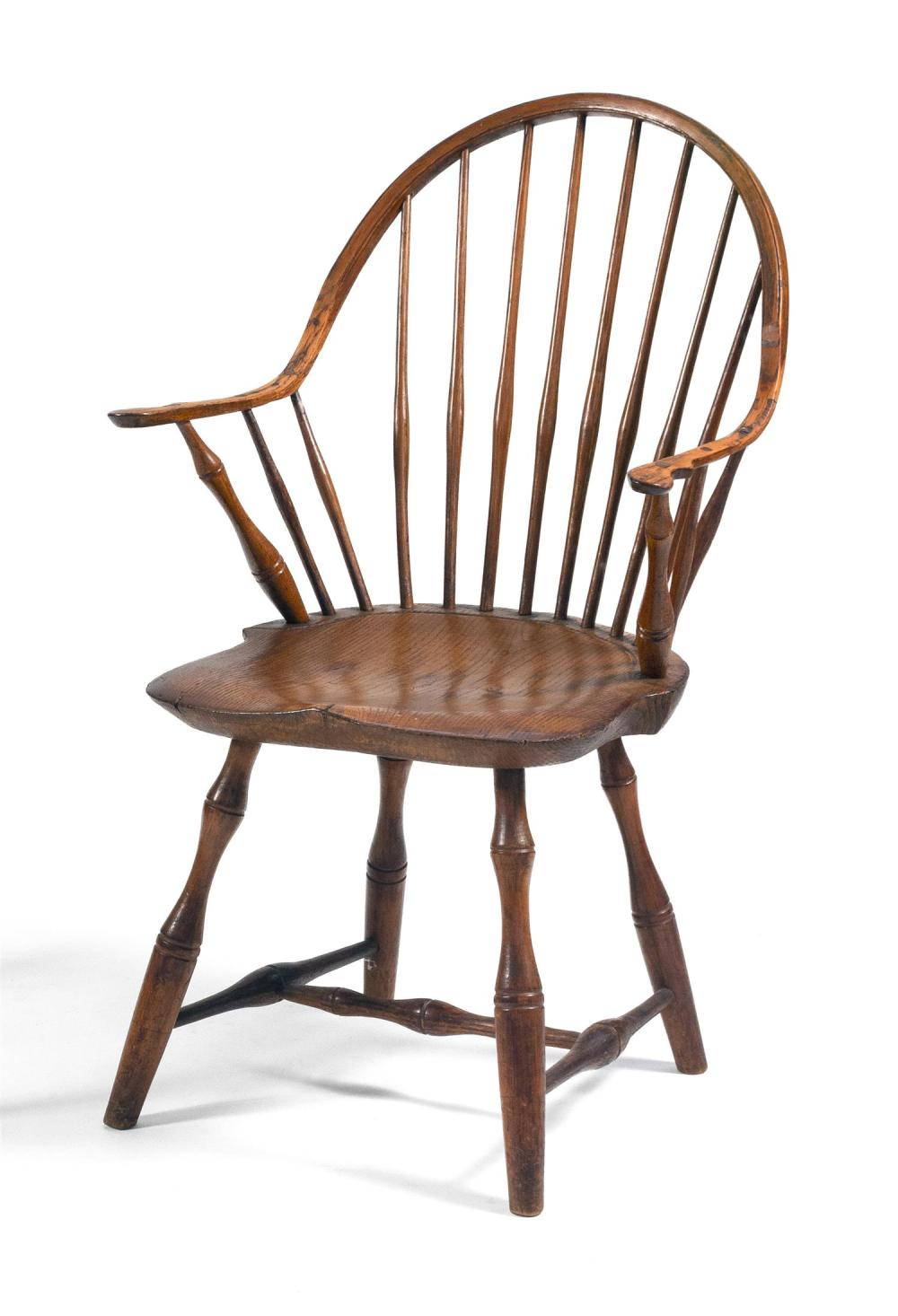 """WINDSOR CONTINUOUS ARMCHAIR In ash and maple. Back height 34.25"""". Seat height 16.5""""."""