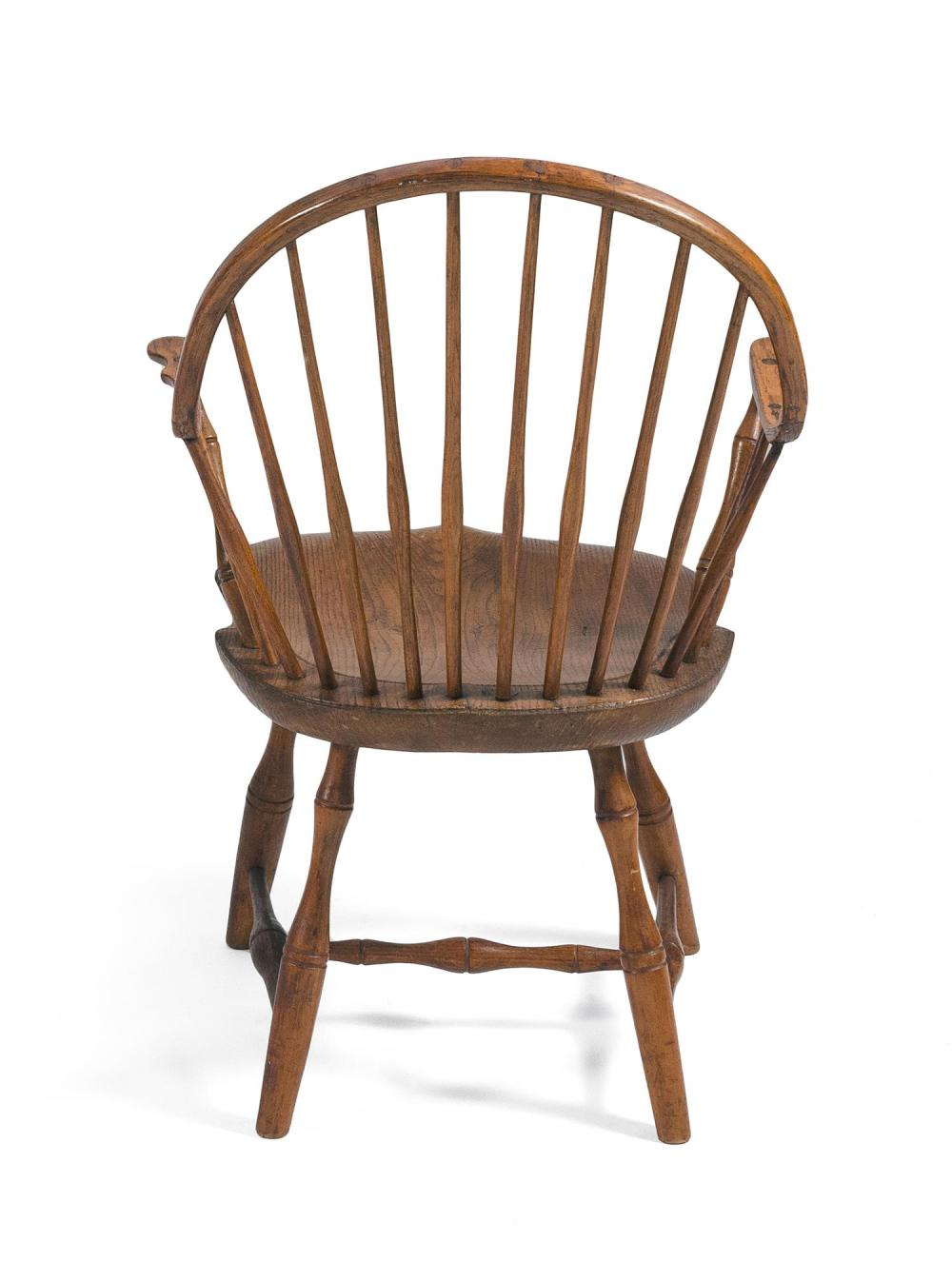 WINDSOR CONTINUOUS ARMCHAIR In ash and maple. Back height 34.25